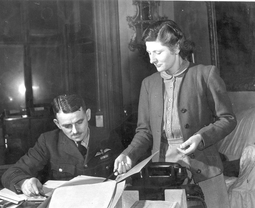 Group Captain Sir Frank Whittle & his secretary Miss Mary Phillips at Brownsover Hall, Rugby.  It was here that  work on the jet engine was carried out from 1940.  1944    IMAGE LOCATION: (Rugby Library) PEOPLE IN PHOTO: Whittle, Frank, Whittle as a surname, Phillips, Mary, Phillips as a surname