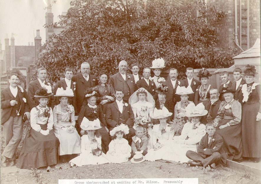 A group photographed at the wedding of Mr Wilson, presumably at Rugby.  1900s |  IMAGE LOCATION: (Rugby Library) PEOPLE IN PHOTO: Wilson as a surname