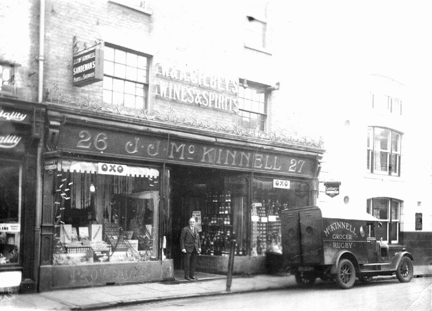 McKinnell's grocery shop in Sheep Street, Rugby, outside stands Mr A.J. Band who has newly purchased it. 1920s [Five years later the business was sold to F W Essex & co. the present proprietors]  |  IMAGE LOCATION: (Rugby Library) PEOPLE IN PHOTO: James, A J, James as a surname