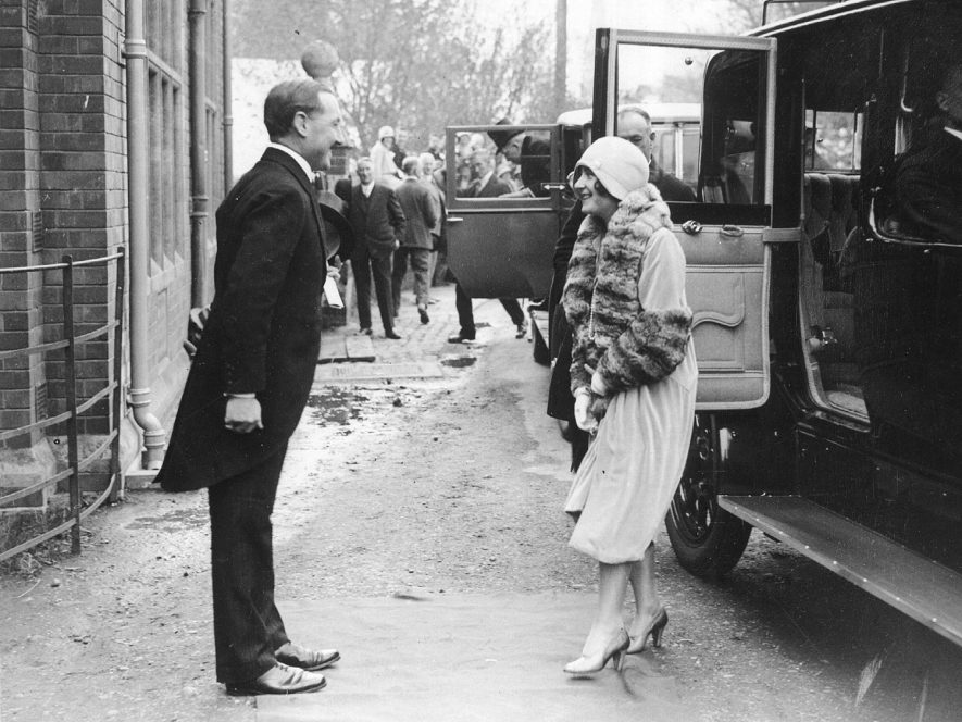 The Duchess of York being greeted on arrival at the entrance to St Cross hospital, Rugby, by Viscount Fielding of Newnham Paddox.  1929 |  IMAGE LOCATION: (Rugby Library) PEOPLE IN PHOTO: York, H R H The Duchess of, Fielding, Viscount