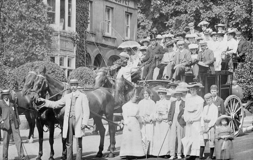 A group of people about to go on an outing, Rugby.  1900s |  IMAGE LOCATION: (Rugby Library)