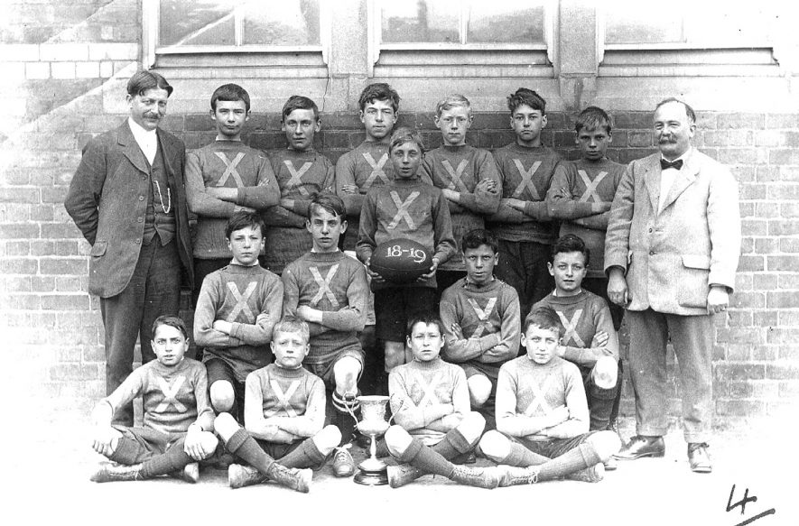 A boys' school rugby team with the cup they won, Rugby.  1919 [It is suggested that this could be Murray School,Rugby with W.T.C.Hodges the Headmaster.] |  IMAGE LOCATION: (Rugby Library)