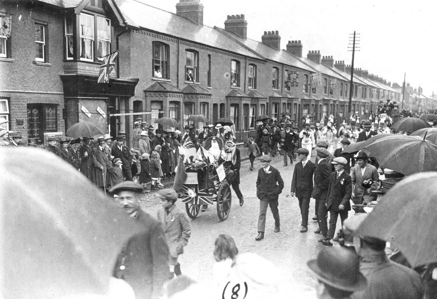 Rugby Armistice procession in Craven Road.  1918 [This photo is almost certainly of the Rugby Peace Celebrations, July 19th 1919. The clothing, leaves on the trees etc are consistent with July, not November. No reference to the 'floats' seen in the photo being present on the procession through Rugby.] |  IMAGE LOCATION: (Rugby Library)