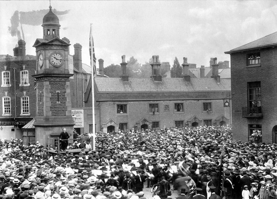 Mr E.R. Stebbing conducting massed bands in the Market Place, Rugby, during the peace celebrations on July 19th 1919. |  IMAGE LOCATION: (Rugby Library) PEOPLE IN PHOTO: Stebbing, Mr G R, Stebbing as a surname