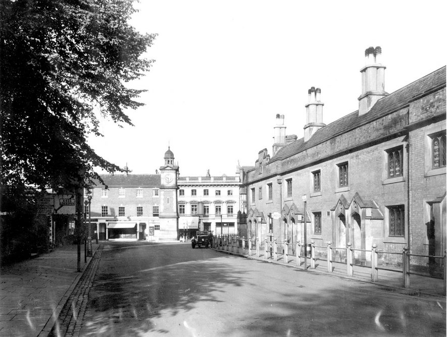 Market Place and Church Street, Rugby, with the Lawrence Sherriff Almshouses on the right.  1935 |  IMAGE LOCATION: (Rugby Library)