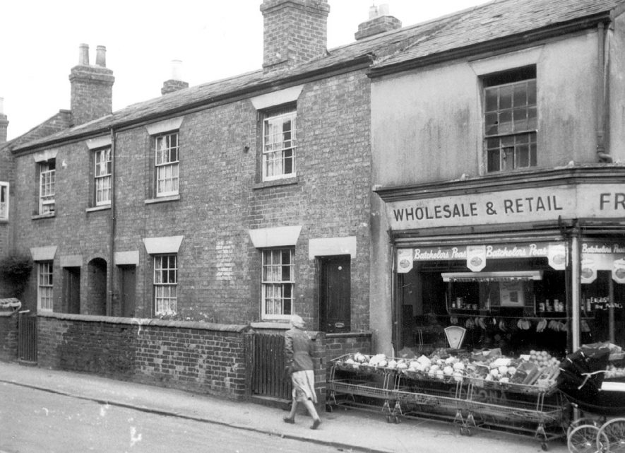 Numbers 23, 24 and 25 West Leys, Rugby, with Bill Smith's fruit & vegetable shop in the foreground. The shop is on the corner of West Leys and West Street. 1936[It has been pointed out that West Leys is actually several hundred yards away from this picture and it is possibly Queens Street][It has been suggested that is Chapel Street on the right angled corner which later became the junction of Chapel Street and Corporation Street.] |  IMAGE LOCATION: (Rugby Library)