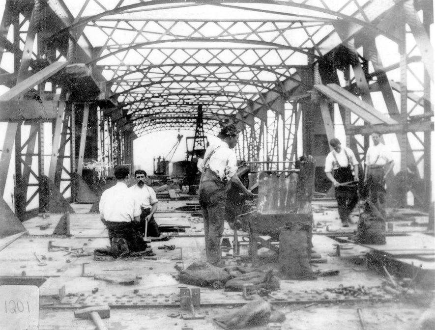 Forgers, rivetters and fitters working on the large steel bridge over the L.N.W.R. at Rugby.  1920s |  IMAGE LOCATION: (Rugby Library)