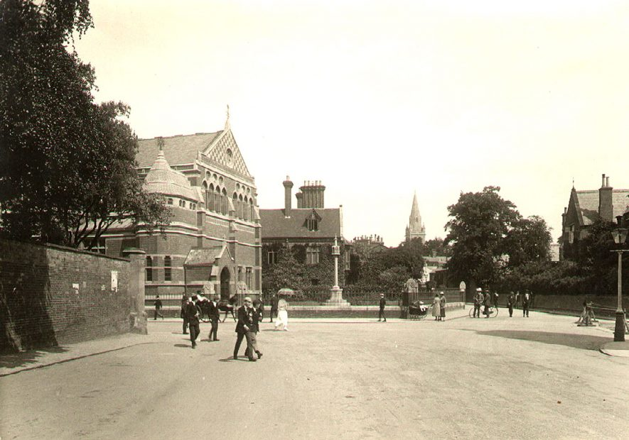Rugby School with pupils and others walking in the street in front.  1920s |  IMAGE LOCATION: (Rugby Library)