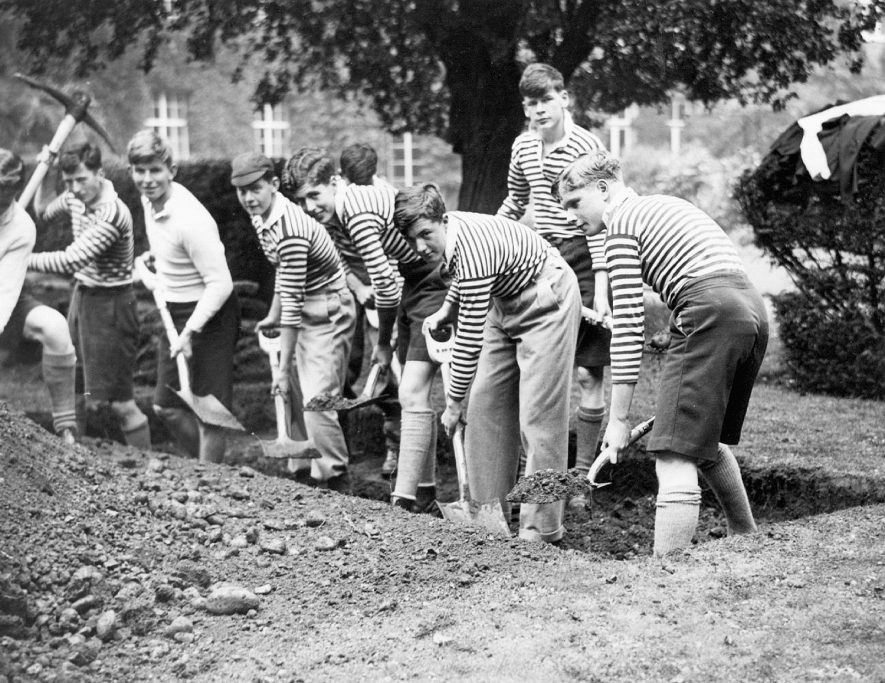 Rugby School boys digging air raid shelters in the rectory garden. 1938 or 1939.Photograph supplied by kind permission of the Rugby Advertiser. |  IMAGE LOCATION: (Rugby Library)