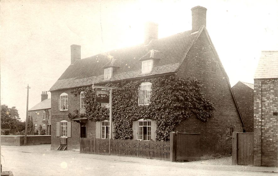 The Bull Inn at Clifton on Dunsmore, showing the cellar entrance on the left.  1900s    IMAGE LOCATION: (Rugby Library)