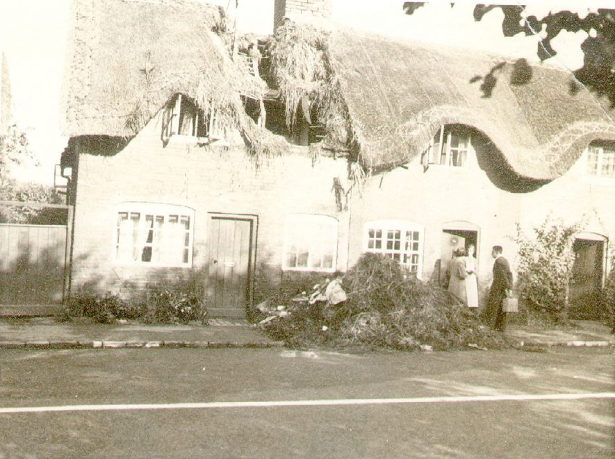 Bomb damaged cottage, Dunchurch.  People in doorway.  Cottage owned by