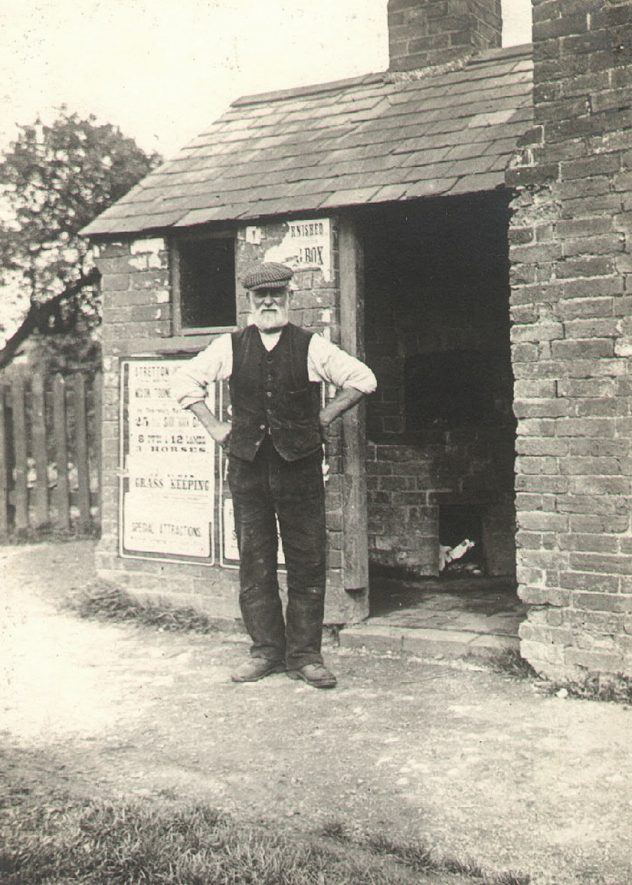 An elderly gentleman standing in front of the parish oven at Kings Newnham. Photographed by F.J. Gibson, 1910s |  IMAGE LOCATION: (Rugby Library)
