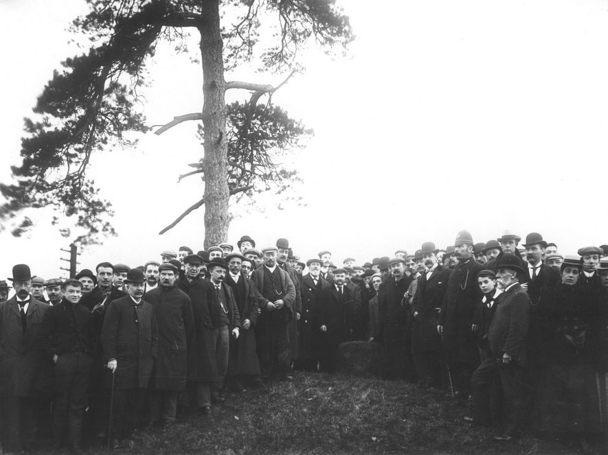 Gathering of men on Knightlow Hill (no longer so named), Ryton on Dunsmore, for the wroth silver ceremony. A tradition of payment, for the use of fields or roadways, that may date back to Saxon times. St Martins'day. 1899    IMAGE LOCATION: (Rugby Library)