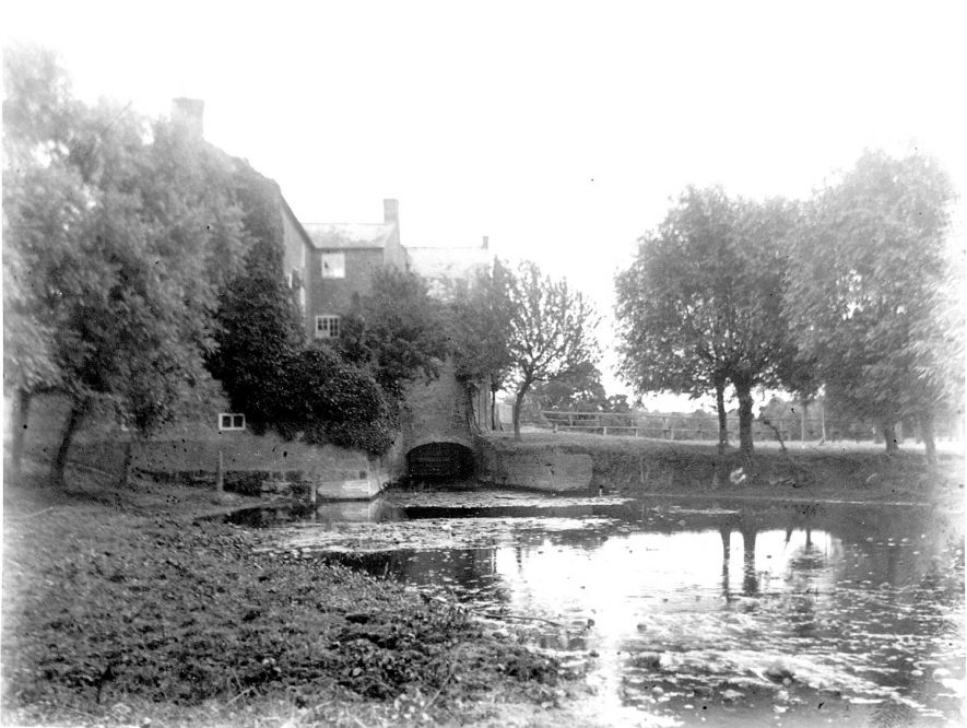 Little Lawford Mill. In 1086 the mill on this site was valued at four shillings. The mill was held by the monks of Pipewell Abbey in the twelfth century. It was leased to Richard Boughton in 1485 and to Henry Wissyter in 1515 at fifty two shillings per annum. From 1828 to 1845 Joseph Dafforn was the miller.  Between 1850 and 1880, George Spokes, E. Brierly, E. Fletcher, T. Foxley and George Eagles are recorded. By 1888 Thomas Foxley had returned to the mill and ran it until about 1904.  In 1908 Robert Russell was the miller and Mrs Russell carried on from 1921 until milling ceased a few years later. The three storey mill building is of brick and adjoins the mill house. The water wheel was removed in the 1940s to ease the passage of flood water. In recent years a small roller mill has been installed and is driven from outside the building by a tractor, to produce animal foodstuffs.  1950s |  IMAGE LOCATION: (Rugby Library)