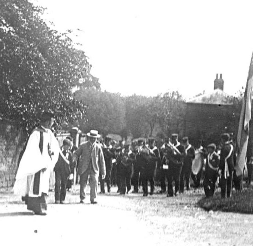 Procession of  brass band led by clergyman, Lower Brailes.  1900s    IMAGE LOCATION: (Warwickshire Museums. Photographic Collections.)