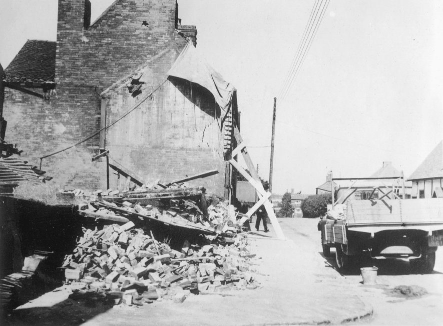 Bomb damaged cottage, with a lorry parked outside, Ryton on Dunsmore.  1940 |  IMAGE LOCATION: (Rugby Library)