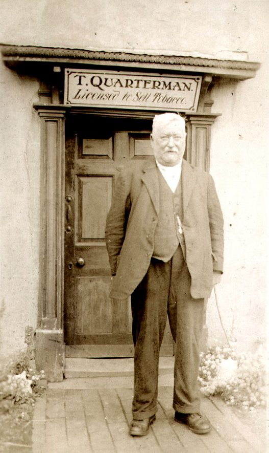 Tom Quarterman, landlord, outside the Dun Cow Inn, Ryton on Dunsmore.  1900s |  IMAGE LOCATION: (Rugby Library) PEOPLE IN PHOTO: Quartermain, Tom, Quartermain as a surname