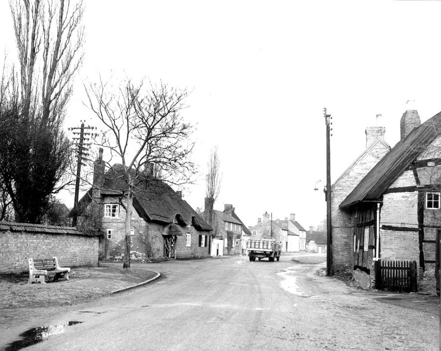 Village street with cottages and a milk truck carrying churns, Thurlaston.  1960 |  IMAGE LOCATION: (Rugby Library)