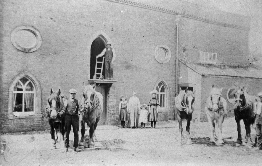 Workers and horses in the yard of Wolston Mill.  Circa 1910 |  IMAGE LOCATION: (Rugby Library)