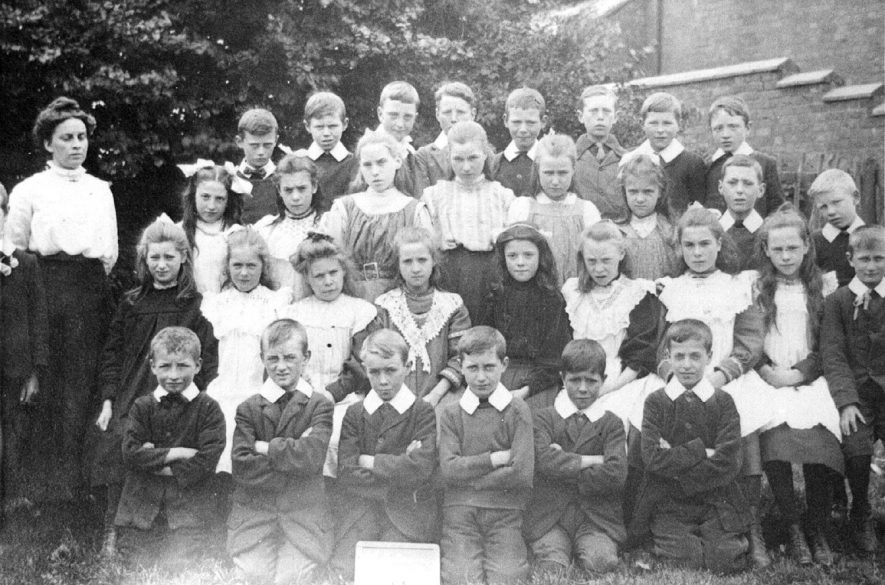 A group of schoolchildren and their teacher in Wolston.  1910s |  IMAGE LOCATION: (Rugby Library)
