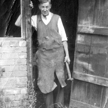 Exhall, nr Alcester.  Mr Mason outside The Forge