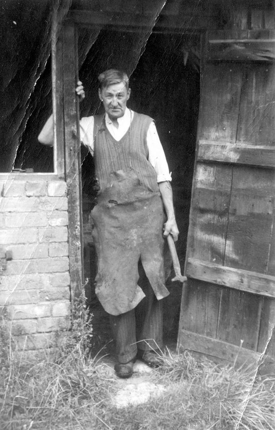 Mr Mason standing at the door of Exhall forge.  1960s |  IMAGE LOCATION: (Warwickshire Museums. Photographic Collections.) PEOPLE IN PHOTO: Mason, Mr, Mason as a surname