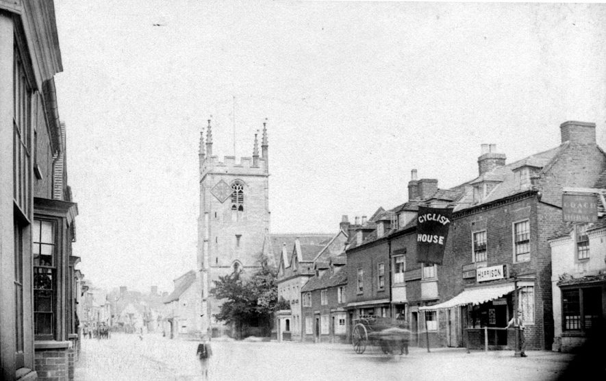 High Street, Henley in Arden. The church of St John the Baptist is also shown.  1888 |  IMAGE LOCATION: (Warwickshire Museums. Photographic Collections.)