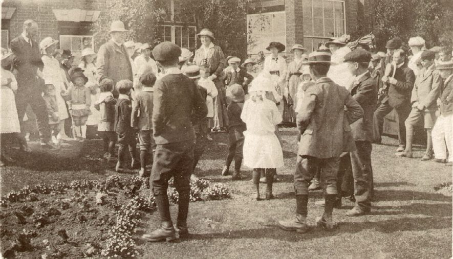 Opening of Great Alne fete at Kinwarton rectory. The Rev. H. Devenish started this fete and is seen standing to the left of picture in a hat. Standing to the very left is Mr R.H. Jeffcoat.  1900s |  IMAGE LOCATION: (Warwickshire Museums. Photographic Collections.) PEOPLE IN PHOTO: Jeffcoat, Mr R H, Jeffcoat as a surname, Devenish, Revd H H, Devenish as a surname
