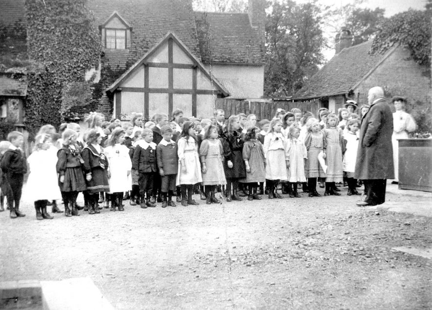 The Marquis of Hertford and schoolchildren in the schoolyard at Arrow. N1900s |  IMAGE LOCATION: (Warwickshire Museums. Photographic Collections.) PEOPLE IN PHOTO: Hertford, The Marquis of