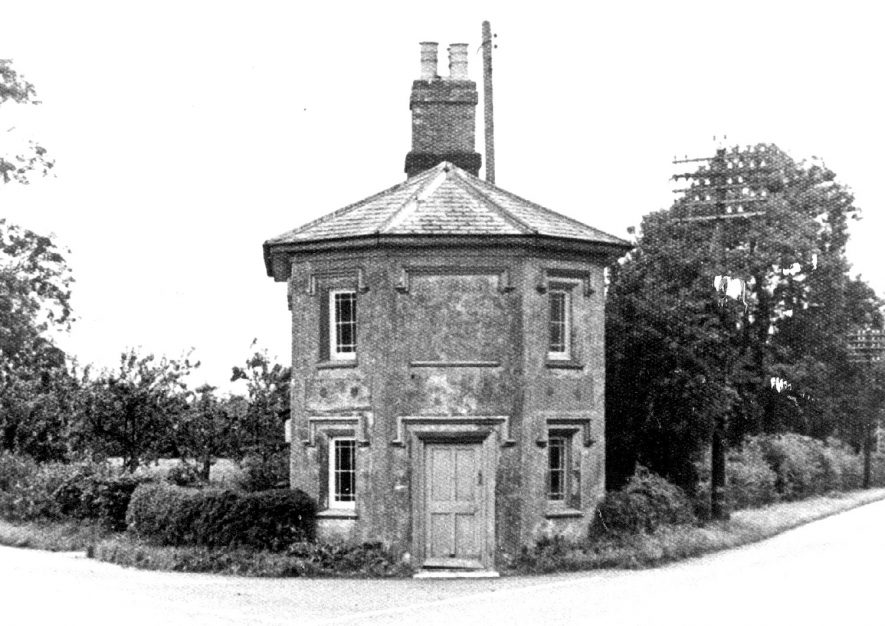 The Tollhouse, King's Coughton, Alcester. This early Victorian tollhouse is a charming example of a type of roadside feature which has suffered greatly from the road improvement schemes of recent years.  1920s |  IMAGE LOCATION: (Warwickshire Museums. Photographic Collections.)