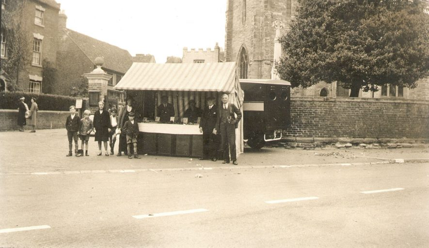 A sidestall at a wartime mop in front of the church in Alcester.  1939 |  IMAGE LOCATION: (Warwickshire Museums. Photographic Collections.)