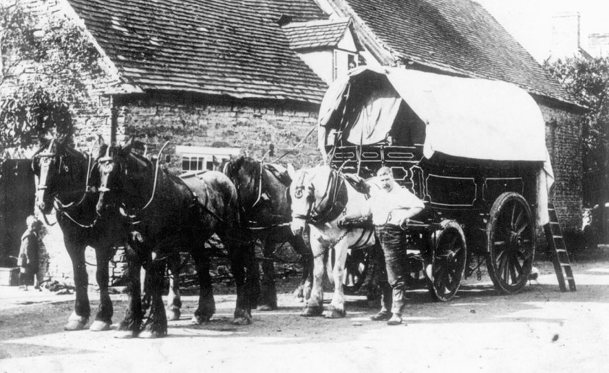 One of J L Sisam's teams from Arrow Mill, Alcester, delivering flour to a bakery. This wagon carried 5 tons. George Clark, coach-builder of Arrow, maintained four of these wagons and Ged Clark used it as a pattern for R.S. Smith's wagon at Clifford Mills.  1910s |  IMAGE LOCATION: (Warwickshire Museums. Photographic Collections.)