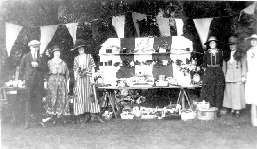 A stall at Alcester church fete in the Rectory Garden. Circa 1925. |  IMAGE LOCATION: (Warwickshire Museums. Photographic Collections.)