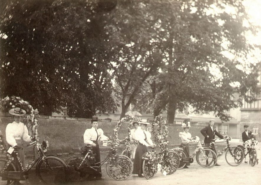 A group of men and women each with decorated bicycles.  Circa 1890 |  IMAGE LOCATION: (Warwickshire Museums. Photographic Collections.)
