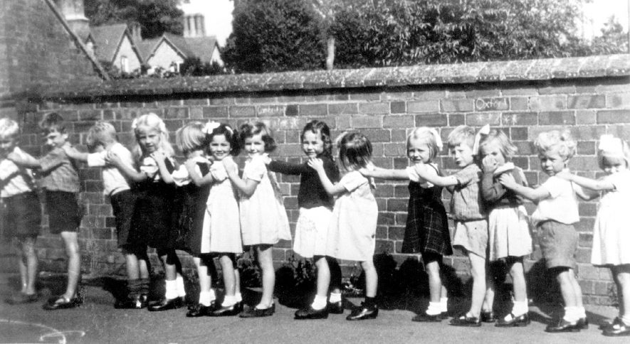 Infants in the school yard at Preston on Stour.  1947 |  IMAGE LOCATION: (Warwickshire Museums. Photographic Collections.)