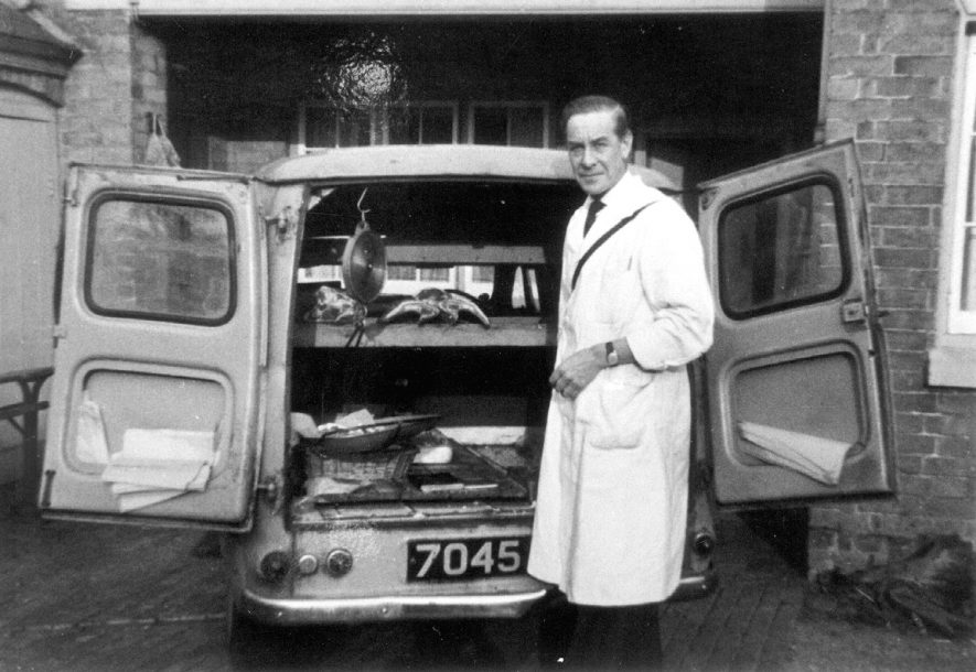 Mr. Dick Passmore, butcher, and his van. Preston on Stour.  1965 |  IMAGE LOCATION: (Warwickshire Museums. Photographic Collections.) PEOPLE IN PHOTO: Passmore, Dick, Passmore as a surname