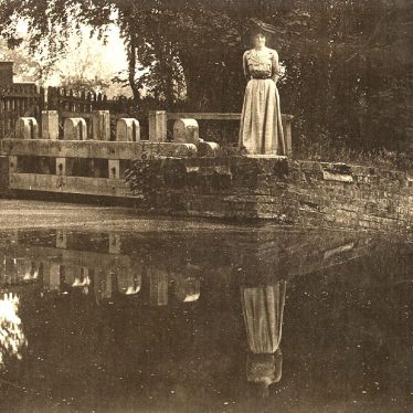 Wootton Wawen.  Lady on bridge