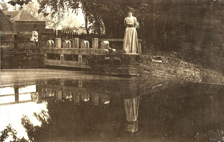 Lady on bridge, Wootton Wawen.  1900s    IMAGE LOCATION: (Warwickshire Museums. Photographic Collections.)