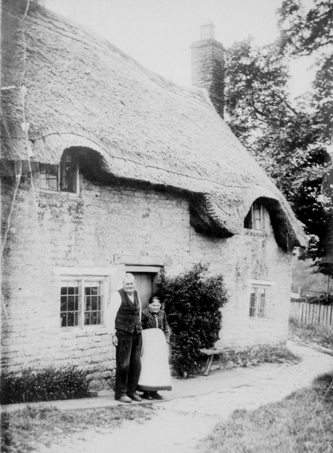 Mr and Mrs Tom Hutchins standing in front of Rosemary Cottage, Lighthorne.  1900s |  IMAGE LOCATION: (Warwickshire Museums. Photographic Collections.)