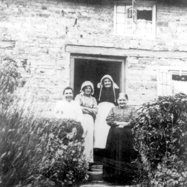 Lighthorne.  Group of women in doorway of a cottage