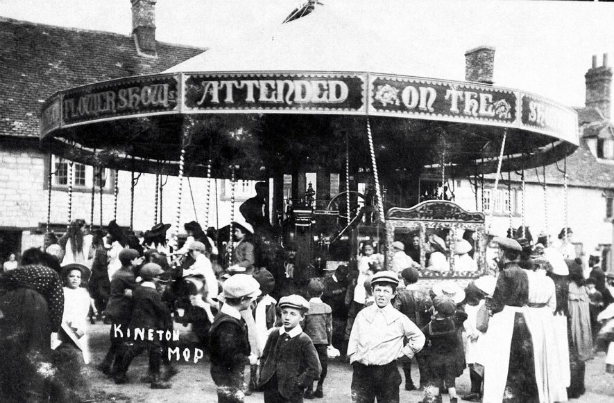 A roundabout ride at Kineton mop fair.  1900s |  IMAGE LOCATION: (Warwickshire Museums. Photographic Collections.)