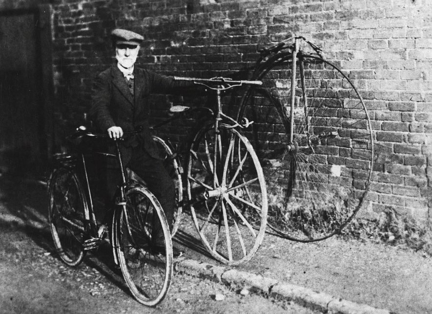 W.R. Fry, cycle shop owner, with three generations of bicycles, Shipston on Stour.  1930s |  IMAGE LOCATION: (Warwickshire Museums. Photographic Collections.) PEOPLE IN PHOTO: Fry, W R, Fry as a surname