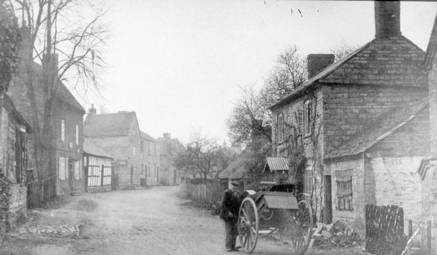 Village street, cottages, man with hand cart, Ardens Grafton.  1910s |  IMAGE LOCATION: (Warwickshire Museums. Photographic Collections.)