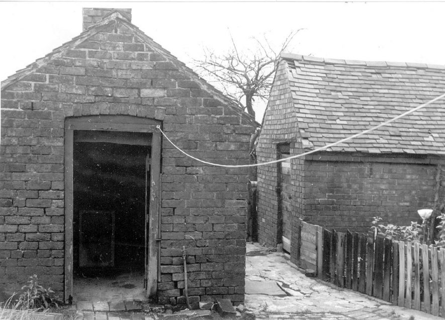 Joint wash house and an outbuilding at back of houses in Church Road, Dordon.  1970s |  IMAGE LOCATION: (Warwickshire Museums. Photographic Collections.)