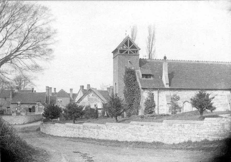 Exterior view of St Mary's church, Bearley, with cottages in the background.  1888 |  IMAGE LOCATION: (Warwickshire Museums. Photographic Collections.)