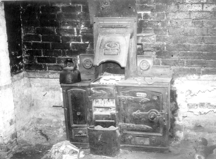 Forge Cottage, Ashorne, before conversion, showing the range in the main downstairs room. The range was to remain after conversion in May 1979. |  IMAGE LOCATION: (Warwickshire Museums. Photographic Collections.)