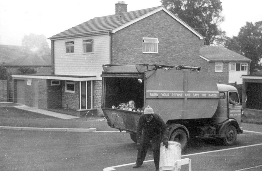 A refuse collection lorry outside a house in Ilmington.  Circa 1967 |  IMAGE LOCATION: (Warwickshire Museums. Photographic Collections.)