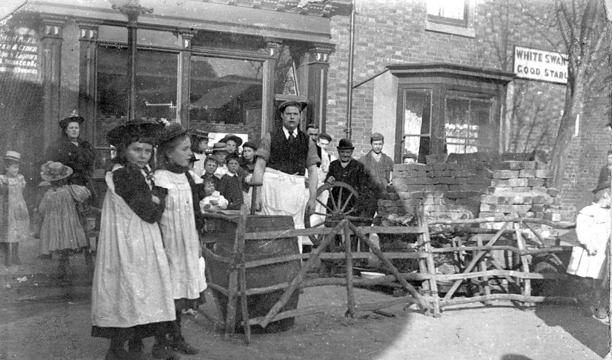 Children and adults at an ox/pig roast at the White Swan hotel, Stratford upon Avon.  1900s |  IMAGE LOCATION: (Warwickshire Museums. Photographic Collections.)