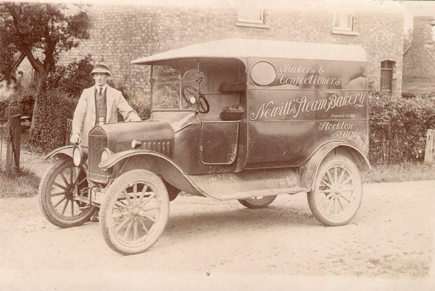 Newitt's steam bakery van with a man standing alongside. Stockton.  1924 |  IMAGE LOCATION: (Warwickshire Museums. Photographic Collections.)