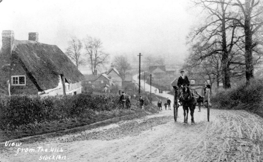View from the Hill, Stockton. Mr Winters on Mr Grants' pony and trap, the baker from Southam who delivered to the Co-op in Stockton.  1902 |  IMAGE LOCATION: (Warwickshire Museums. Photographic Collections.) PEOPLE IN PHOTO: Winters, Mr, Winters as a surname